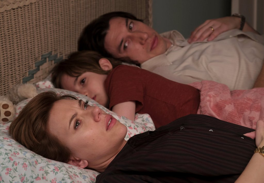 Image still from Marriage Story- Nicole (Scarlett Johansson) and Charlie (Adam Driver) laying in bed together with their son.