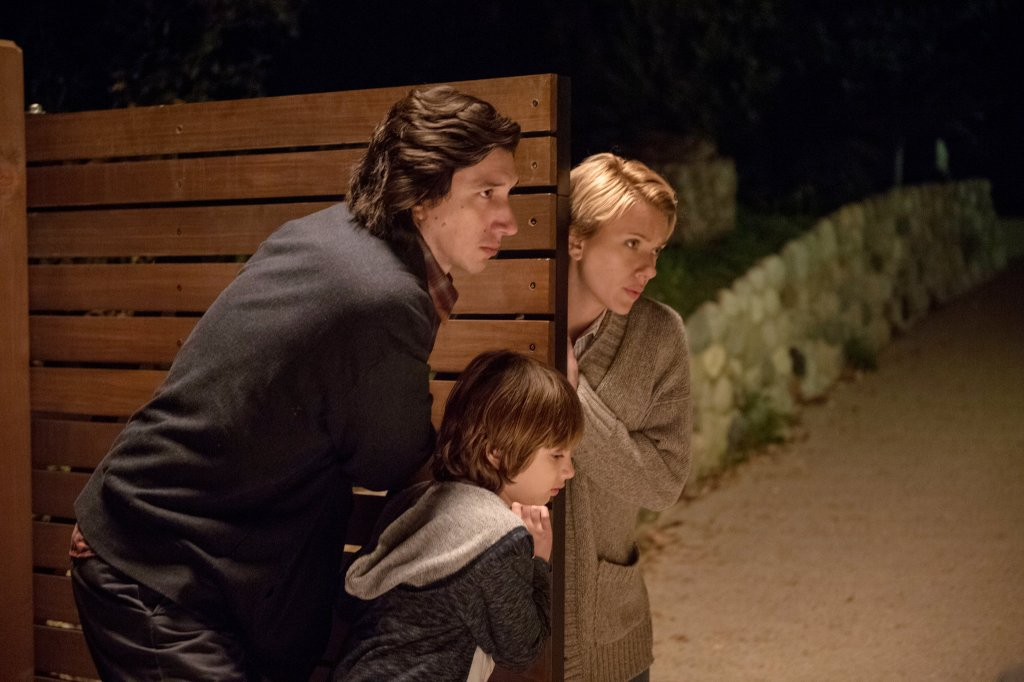 Image still from Marriage Story- Nicole (Scarlett Johansson) and Charlie (Adam Driver) with their son pushing a door closed.