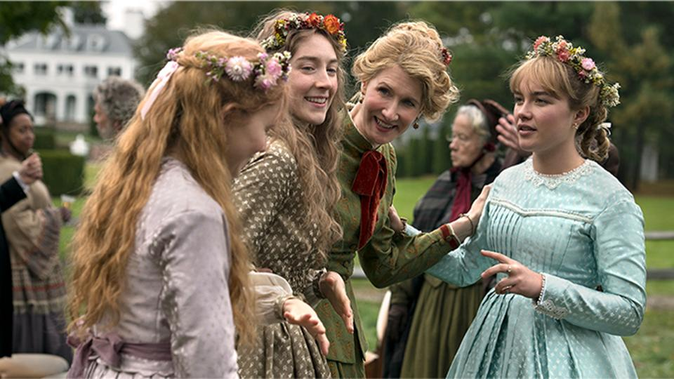 Image still from Little Women- Jo (Saoirse Ronan), Amy (Florence Pugh), and Beth (Eliza Scanlon) are talking to their Mamie (Laura Dern.)