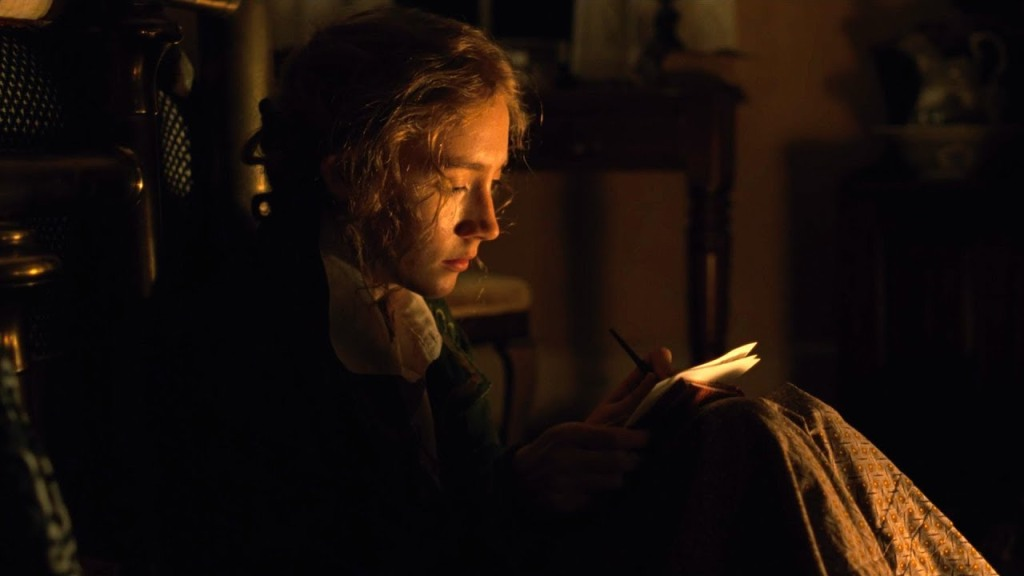 Image still from Marriage Story- Jo March (Saoirse Ronan) writing in a candle-lit room.
