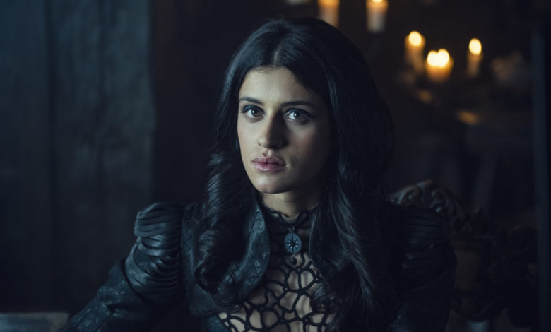 Image still from The Witcher- Close up of Yennefer of Vengerberg (Anya Chalotra) sitting at a table.
