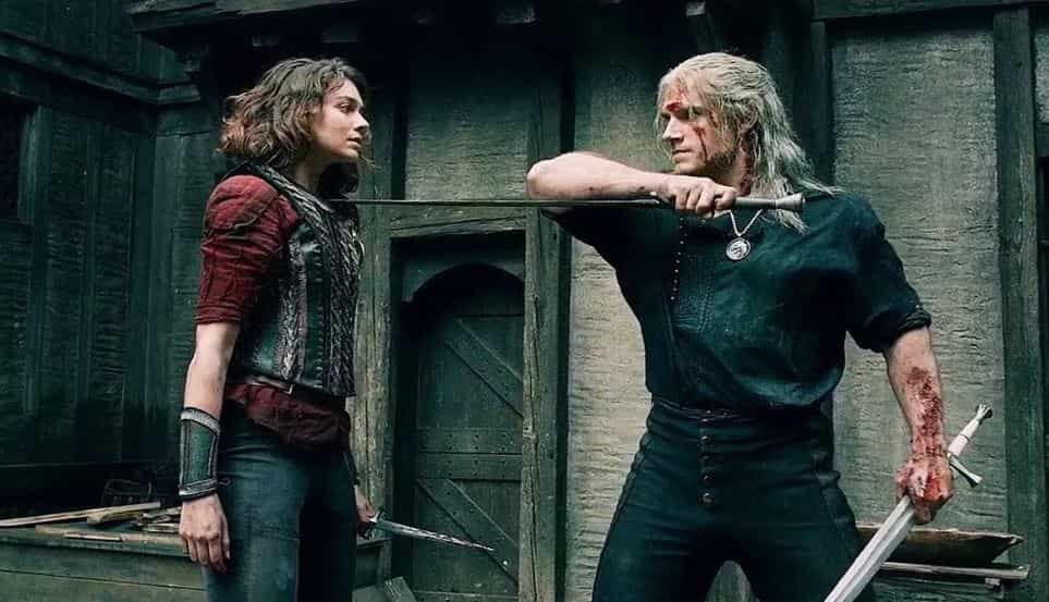 Image still from The Witcher- The Witcher (Henry Cavil) is fighting a woman.