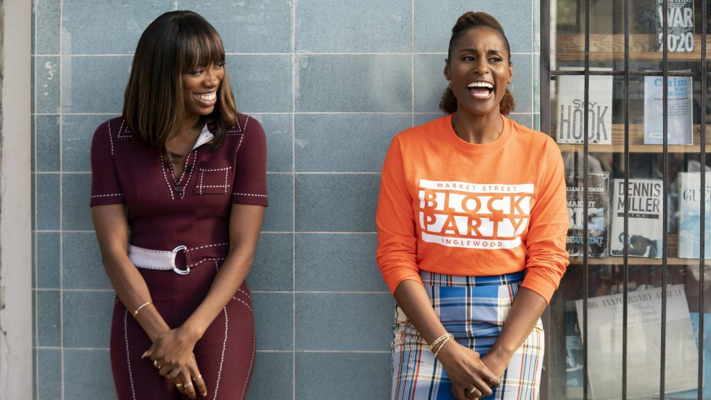 Image still from Insecure- Molly (Yvonne Orji) and Issa (Issa Rae) are laughing together.