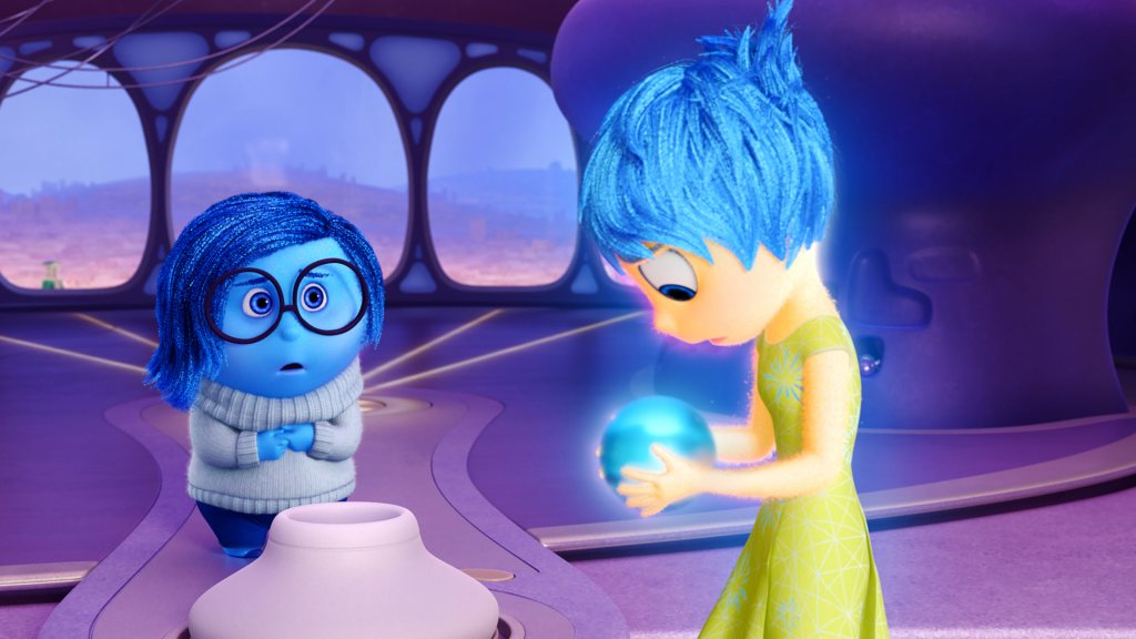 Image still from Inside Out- Joy and Sadness looking at a small orb together.