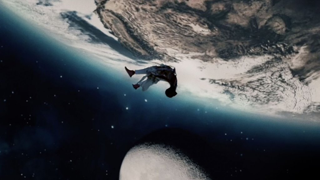 Image still from Black is King- a kid is seen falling, from space to Earth