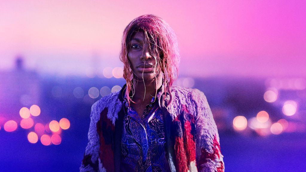 Image still from I May Destroy You- Michaela Coel is looking into the camera, drenched in water